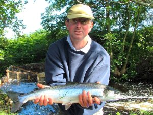 Fresh from the sea - Peter Cunningham with fresh run grilse (Ben Rushbrooke)