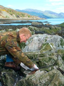 Colin MacDonald collecting seal scat for diet analysis