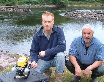 Aaron Forsythe and John Sangster with ROV by the River Ewe at start of salmon filming in August 2008