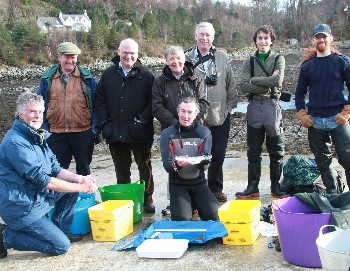 The WRFT-AST sweep netting team (& a sea trout) at Flowerdale 19 Feb 2014 (photo by Ben Rushbrooke)